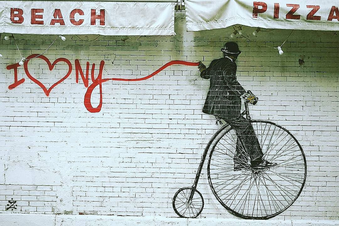 Who doesn't love New York while graffiti-ing, penny-farthing, and eating pizza? . . .